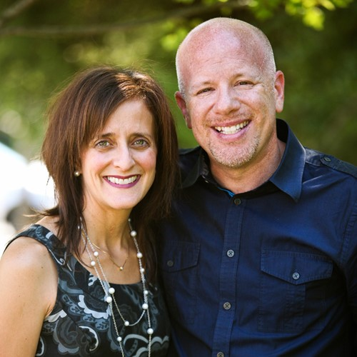 headshot of scott and beth volk